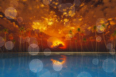 Moon in clouds over red sunset blur Royalty Free Stock Photo