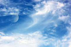 The moon and clouds in the sky Royalty Free Stock Photo