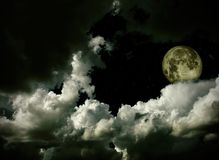 Moon with clouds and stars Royalty Free Stock Photo
