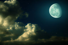 Moon, clouds and stars night landscape Royalty Free Stock Photography
