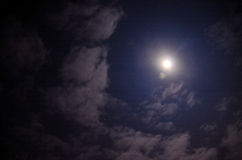 Moon and clouds with stars on sky Stock Images