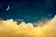 Moon and Cloudscape. A fantasy cloudscape with stars and a crescent moon overlaid with a vintage, textured watercolor paper background