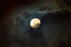 The Moon at Cloudy Night. The moon covered by the clouds at cloudy night in the monsoon season. Long exposure photography stock photography