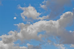 Moon in a cloudy sky Royalty Free Stock Photo