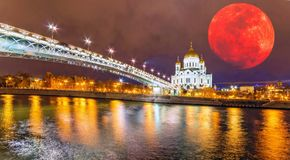 Moon collage of wide angle night view of famous illuminated orth royalty free stock images
