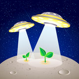 Moon colonization. UFO-like spaceships cultivating the plants at Moon surface Royalty Free Stock Image