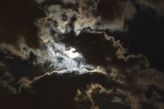 The moon coming through the clouds Royalty Free Stock Photography