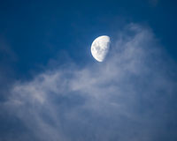 Moon Coming Out of Slightly Pink Cirrus Clouds Royalty Free Stock Photos