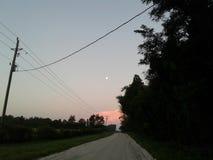 7:30 am moon an cotton candy sky stock photos