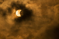 The Moon covering the Sun in a partial eclipse. With dramatic cloud. Scientific background, astronomical phenomenon Royalty Free Stock Photography