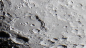 Moon crater Clavius Crater Clavius 225 km Moons surface showing the effects of Earths atmosphere on the view. stock footage