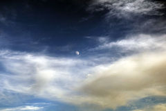 Moon with crescent clouds. Cloudy moon sky beautiful awesome outside outdoor blue Royalty Free Stock Photo