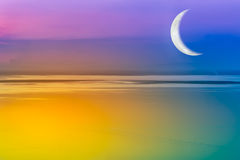 Moon crescent and colorful sky. Outdoors. Moon crescent and colorful sky. Romantic scenic with crescent moon over fantastic sea just after sunset. Outdoors. The Stock Photos