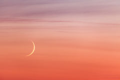 Moon crescent and pastel colors sunset sky Royalty Free Stock Image