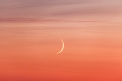 Moon crescent and pastel colors sunset sky Stock Image