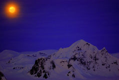Moon on the dark blue sky of Antarctica. Moon on the dark blue sky among mountains. Antarctica Stock Photography