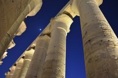 Moon Above Temple Columns in Ancient Egypt royalty free stock photography