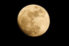 Moon in dark sky. Almost full moon tele photo Stock Photography