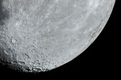 Moon details and craters observing over telescope stock photography