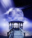 Moon and dock Stock Photo