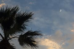 Moon on dramatic sunset sky with clouds Royalty Free Stock Photos