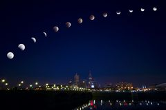 Moon eclipse over city stock image