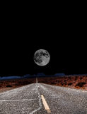 Moon at end  of Road Royalty Free Stock Images