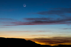 The moon in the evening sky Royalty Free Stock Photography