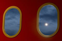 Moon on the evening sky. Seen through the oval window Royalty Free Stock Photos