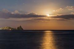 Moon between the faraglioni Stock Image