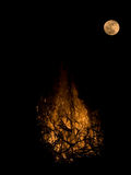 Moon and Fire Stock Photo