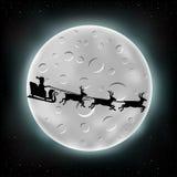 Moon and flying Santa Stock Image