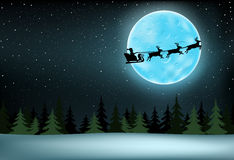 Moon and flying Santa Stock Images