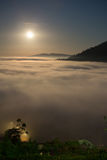 Moon and fog in the morning with mountain at Khao Kho, Thailand Stock Photo
