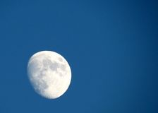 The Moon. Almost a full moon in a clear sky at dusk royalty free stock photography