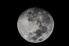 The moon. The full moon at night against a black background Stock Photography