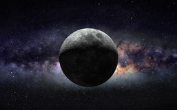Moon and galaxy. An image of half moon against the center of Milky Way galaxy Royalty Free Stock Image