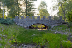 Moon Gate, river over rocks stones and grass. The view on bridge moon gate with green grass and round stones Stock Photos