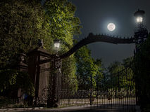 Moon and gates. Moon and iron gates at nighttime Royalty Free Stock Photography