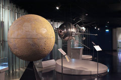 Moon globe and satellite in Space Museum Royalty Free Stock Image