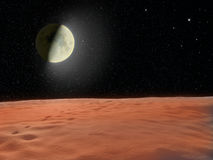 Moon glowing near the surface unknown planet Royalty Free Stock Photos