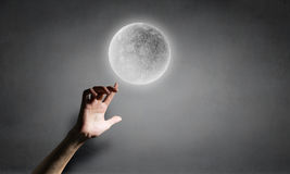 Moon in hand Royalty Free Stock Photography