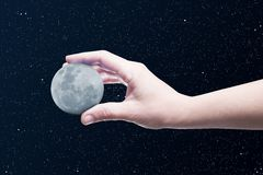 Moon in a hand Royalty Free Stock Photography