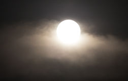 The moon in the haze of the clouds at night Royalty Free Stock Images