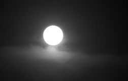 The moon in the haze of the clouds at night.  Royalty Free Stock Image