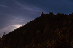 The moon hid behind a hill Stock Image