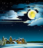 Moon and houses winter Stock Images