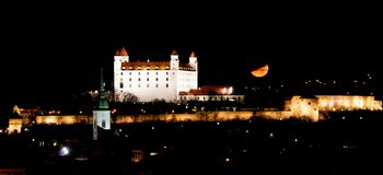 Moon and illuminated Bratislava castle Stock Image