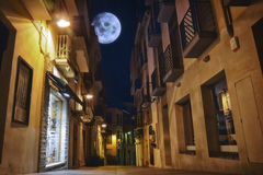 The moon illuminates the sleeping town. Spain, Costa Brava, Palamos Royalty Free Stock Image