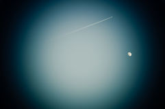 The Moon and jetliner in the lens Royalty Free Stock Photo